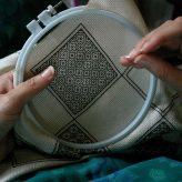 What's the distinction between embroidery and needlepoint?